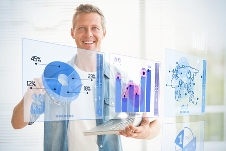 digitally generated image: Digitally generated image of pie chart and bar graph against smiling businessman holding a laptop