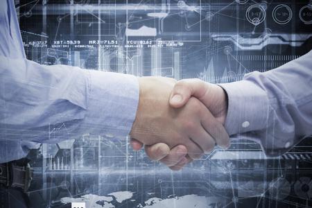 shaking hands: Two men shaking hands against hologram background