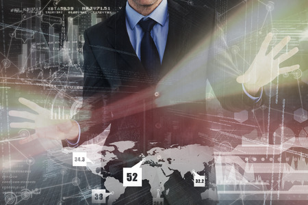 thirties: Businessman standing with fingers spread out against hologram background Stock Photo
