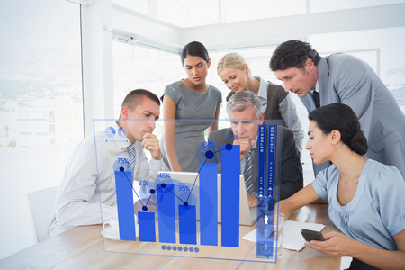 Percentages graphical representation against concentrated business team working on laptop