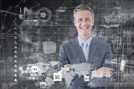 businessman standing: Portrait of smiling businessman standing hands folded against hologram background
