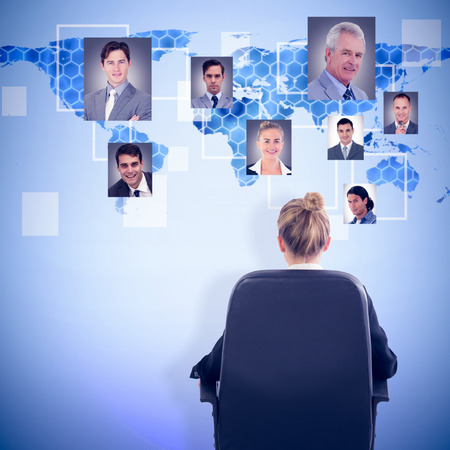 swivel chair: Businesswoman sitting on swivel chair against background with hexagons and world map