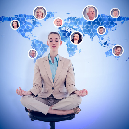 swivel chair: Peaceful chic businesswoman sitting in lotus position on swivel chair against background with hexagons and world map
