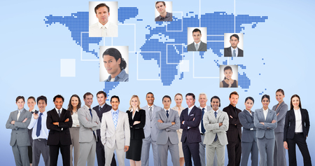 Business people standing up against blue background photo