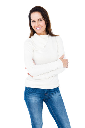 crossing arms: Smiling woman crossing arms on white backgound Stock Photo