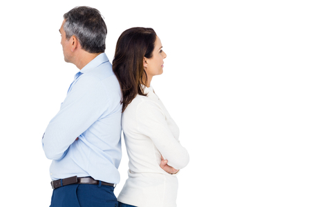 strife: Couple ignoring each other against white background