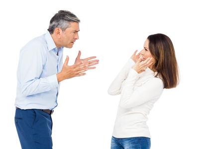 strife: Annoyed man yelling at wife against white background