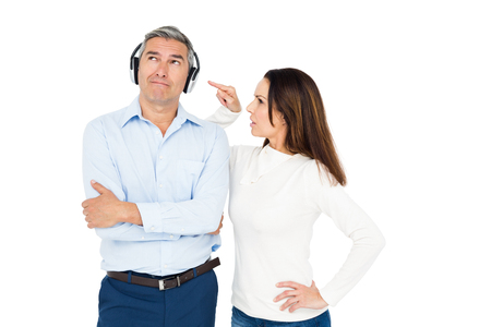 ignoring: Angry couple arguing and ignoring each other on white background Stock Photo