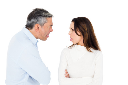 sticking out tongue: Angry couple sticking out tongue on white background Stock Photo