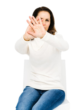 lonesomeness: Unhappy woman hiding her face with hands against white background Stock Photo