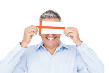 covering eyes: Handsome man covering eyes with gift on white background Stock Photo