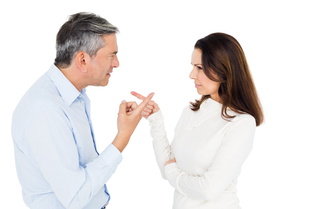 strife: Angry couple arguing on white background