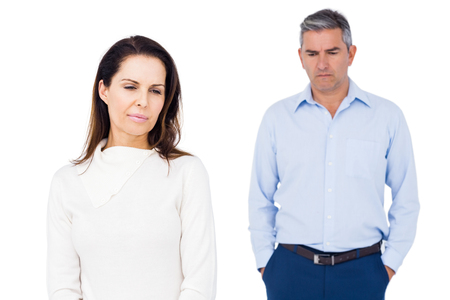 ignoring: Angry couple ignoring each other against white background Stock Photo