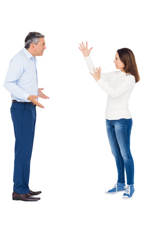 against white: Couple arguing while standing against white background