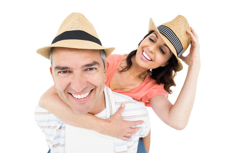 white backing: Handsome man piggy backing his wife against white background