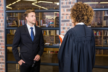 interacting: Lawyer interacting with businessman in office