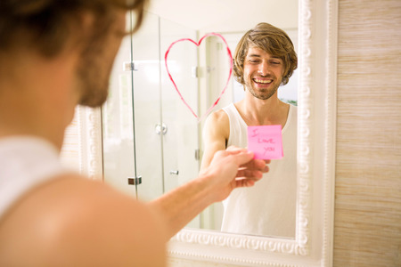 discovering: Boyfriend discovering a love message on the mirror in the bathroom at home