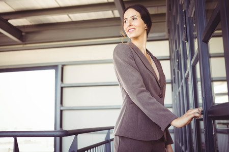 confident business woman: Young businesswoman opening office door Stock Photo
