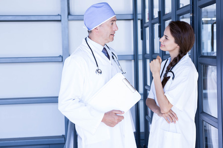 each: Doctors interacting with each other in hospital Stock Photo