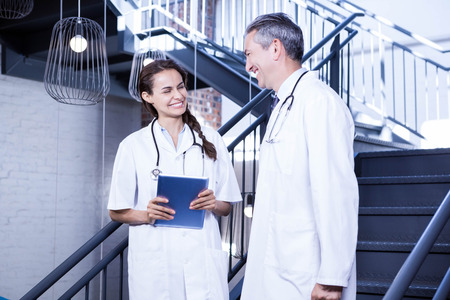 each other: Doctors interacting with each other in hospital Stock Photo