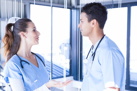 interacting: Doctors interacting with each other in hospital Stock Photo