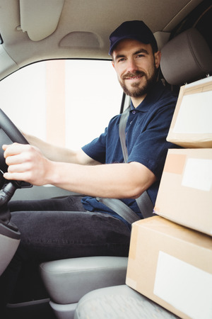 delivery van: Delivery man driving his van with packages on the front seat
