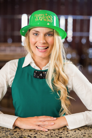 st  patty: Woman wearing saint Patricks day hat in a bar