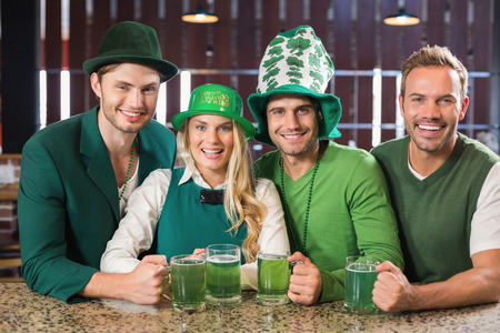 saint patty: Friends wearing St. Patricks day associated clothes in a bar Stock Photo
