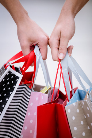 weekend activity: Close-up of two women carrying shopping bags while shopping in mall Stock Photo
