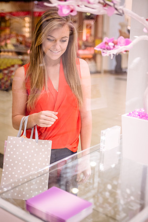 selecting: Beautiful woman selecting a wrist watch in a shop Stock Photo