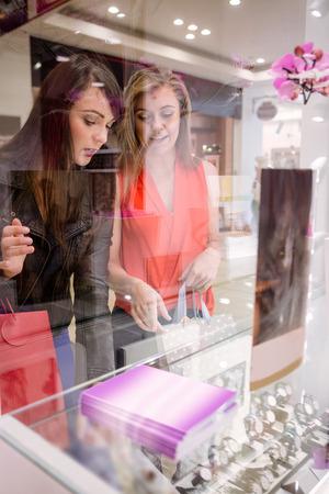 wrist watch: Two beautiful women selecting a wrist watch in a shop Stock Photo