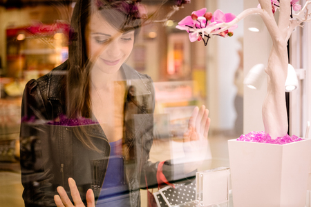 Beautiful woman window shopping in mall Stock Photo