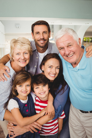 Portrait of cheerful family standing at home Stock Photo