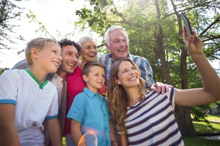 Smiling family taking selfie in the garden Stock Photo