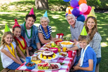 Happy family celebrating a birthday in the park Stock Photo