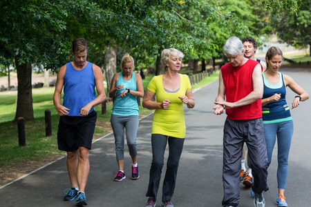 heart rate: Marathon athletes taking their heart rate in park