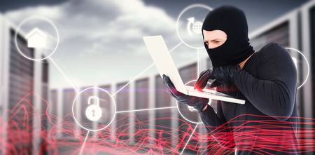 Hacker using laptop to steal identity against futuristic glowing lines on black background Stock Photo