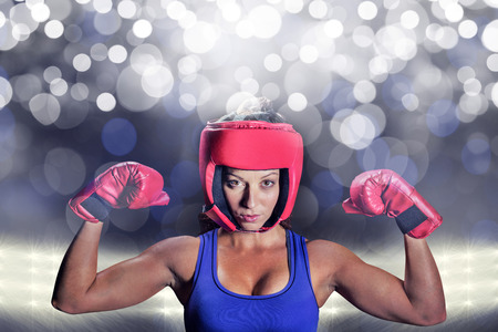 headgear: Portrait of female fighter with gloves and headgear against spotlight