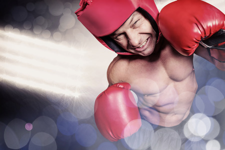 headgear: High angle view of boxer with headgear and gloves against spotlights Stock Photo