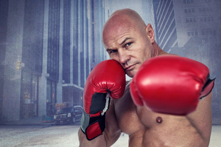 fighting stance: Portrait of boxer with fighting stance against urban projection on wall