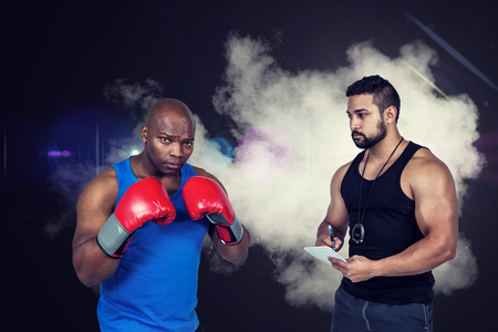 strong: Strong friends using kettlebells together against smoke Stock Photo