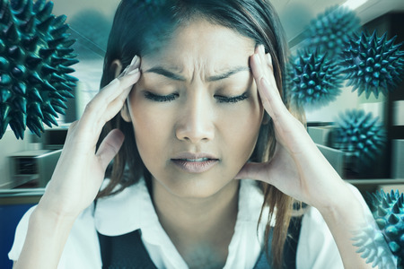 units: Nervous businesswoman holding her head against empty office with separate units