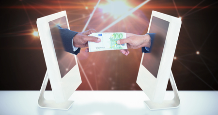 exchanging: Businessmen shaking hands and exchanging money against lines on glowing background
