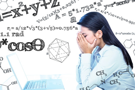 Worried businesswoman covering face against geometry problem