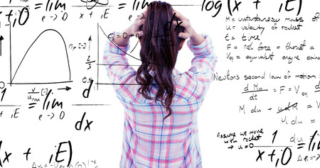 sticky hands: Brunette with hands on hair in front of sticky notes on wooden wall against maths equation Stock Photo