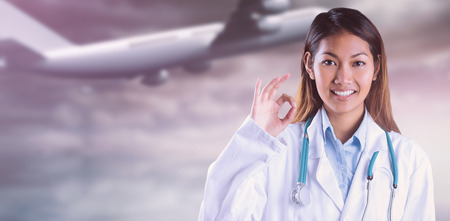 heavenly: Asian doctor doing ok sign against heavenly water and sky Stock Photo