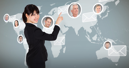 earth map: Smiling businesswoman pointing against map with emails