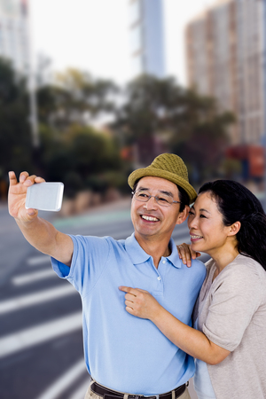 high def: Man and woman taking a picture against new york street