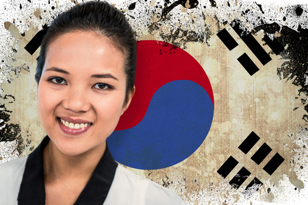 republic of korea: Smiling businesswoman with notes against korea republic flag in grunge effect
