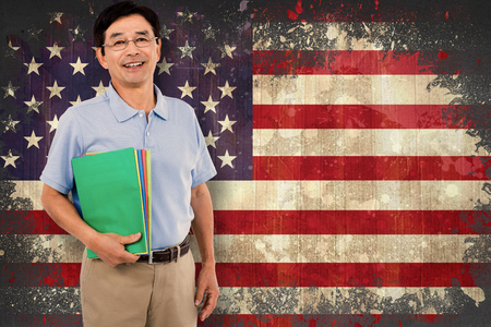 visions of america: Portrait of happy businessman with files against usa flag in grunge effect